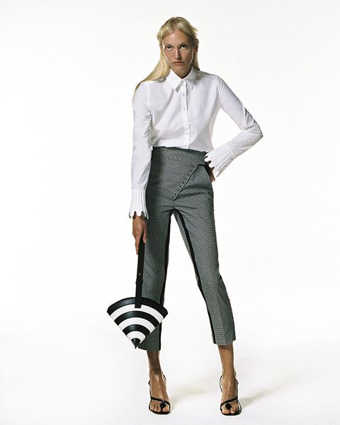 Clothing, White, Waist, Fashion model, Formal wear, Standing, Shoulder, Fashion, Trousers, Suit,
