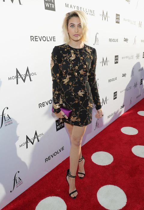 Red carpet, Clothing, Dress, Carpet, Red, Cocktail dress, Hairstyle, Fashion, Flooring, Footwear,