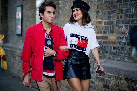 Street fashion, Clothing, Fashion, Red, Snapshot, T-shirt, Street, Infrastructure, Photography, Headgear,