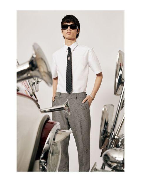 Clothing, White, Suit, Eyewear, Formal wear, Fashion, Outerwear, Trousers, Collar, Dress shirt,