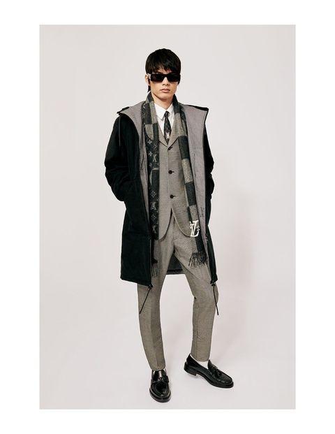 Clothing, Trench coat, Coat, Overcoat, Outerwear, Fashion, Suit, Eyewear, Jacket, Beige,