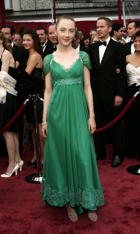 Dress, Gown, Red carpet, Carpet, Clothing, Premiere, Flooring, Shoulder, Formal wear, Event,