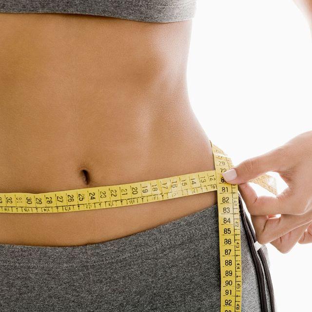Abdomen, Waist, Navel, Stomach, Trunk, Yellow, Organ, Tape measure, Joint, Human body,