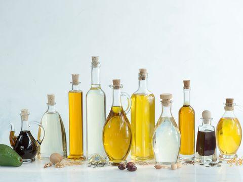 Bottle, Glass bottle, Liqueur, Wine bottle, Drink, Product, Yellow, Alcohol, Barware, Distilled beverage,