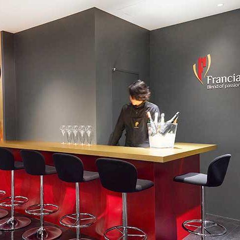 Furniture, Table, Logo, Chair, Bar stool, Design, Desk, Stool, Varnish, Sweater,