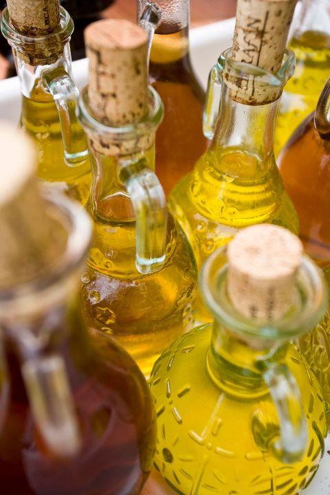 Yellow, Vegetable oil, Glass bottle, Bottle, Cooking oil, Drink, Liqueur, Olive oil, Alcohol, Oil,