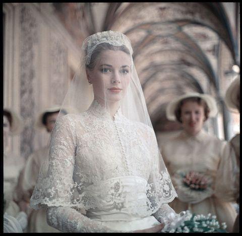 Clothing, Bridal veil, Eye, Veil, Bridal clothing, Eyebrow, Photograph, Wedding dress, Bridal accessory, Dress,