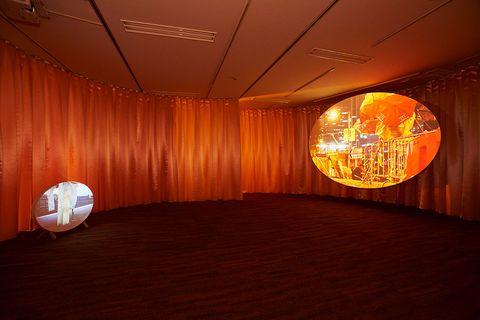 Orange, Light, Lighting, Amber, Ceiling, Room, Interior design, Lighting accessory, Light fixture, Tints and shades,