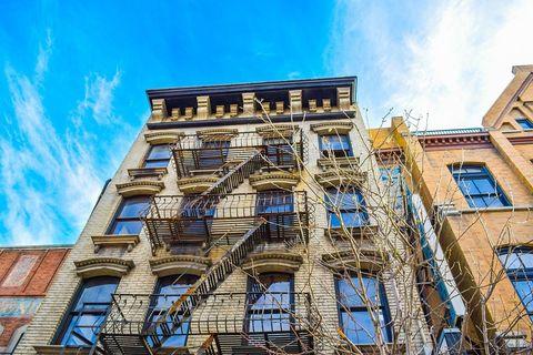 Architecture, Blue, Sky, Facade, Building, Urban area, Landmark, Town, Yellow, City,