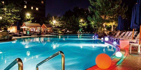 Swimming pool, Leisure, Resort, Lighting, Resort town, Vacation, Night, Hotel, Building, Fun,