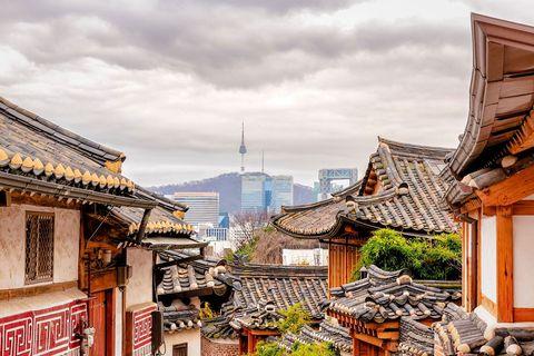Town, Sky, Building, Architecture, Roof, Human settlement, Cloud, City, Neighbourhood, Street,