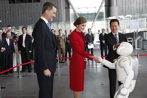Event, Suit, Uniform, Flight attendant, Formal wear, White-collar worker, Gesture,