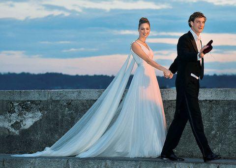 Wedding dress, Photograph, Bride, Gown, Dress, Bridal clothing, Sky, Blue, Wedding, Formal wear,