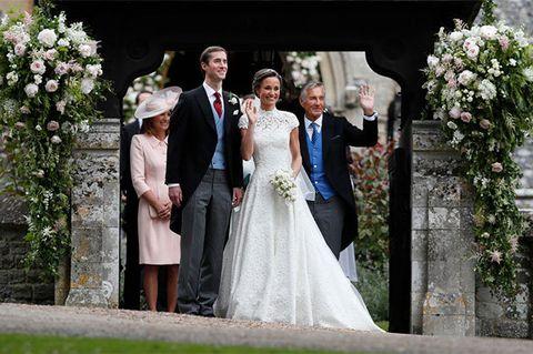 Clothing, Coat, Dress, Bridal clothing, Trousers, Event, Petal, Photograph, Suit, Outerwear,