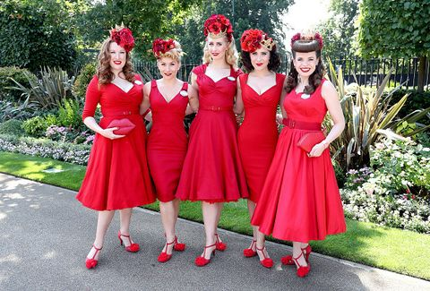 Clothing, Smile, Dress, Red, Social group, Pink, Formal wear, One-piece garment, Garden, Costume accessory,