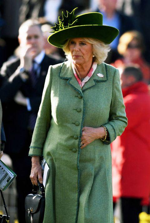 Green, Fashion, Hat, Fedora, Human, Headgear, Street fashion, Coat, Uniform, Event,