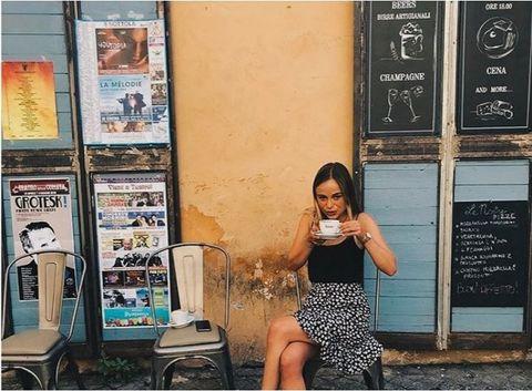 Snapshot, Sitting, Leg, Photography, Dress, Long hair, Vacation, Human leg, Street fashion, Black hair,