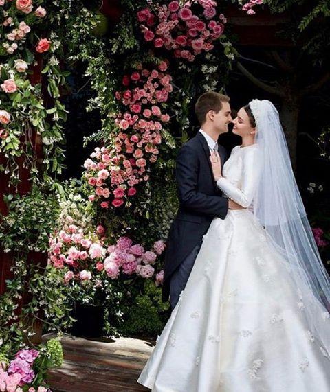 Clothing, Petal, Bridal veil, Veil, Bridal clothing, Photograph, Dress, Flower, Pink, Formal wear,