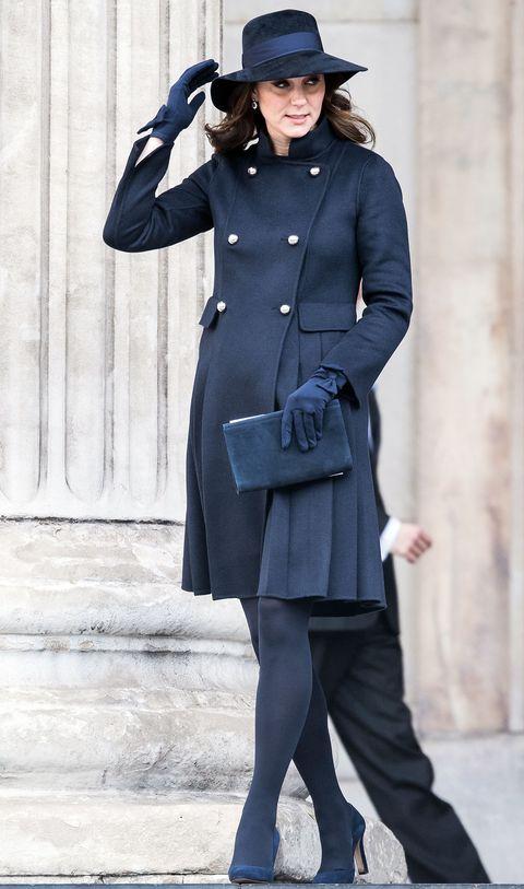 Clothing, Coat, Overcoat, Trench coat, Standing, Fashion, Street fashion, Outerwear, Uniform, Frock coat,
