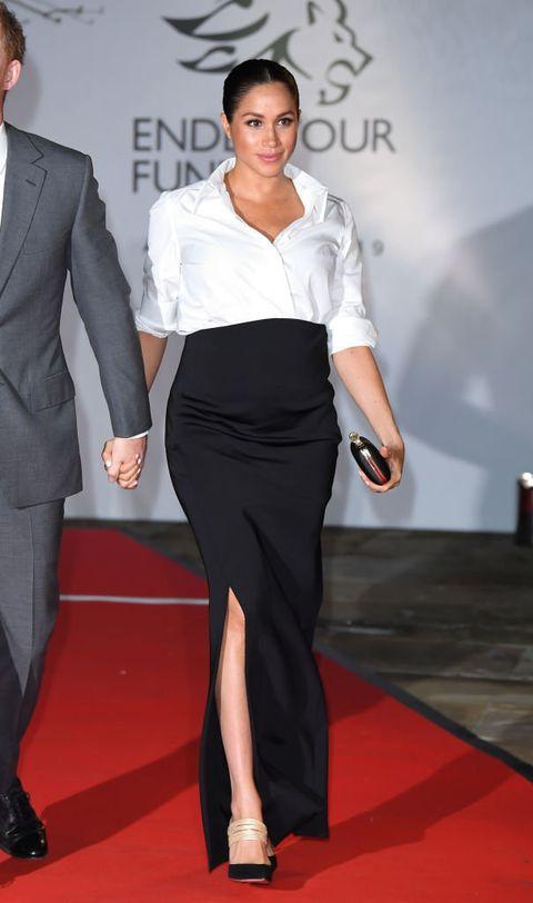 Clothing, Suit, Red carpet, Fashion, Formal wear, Shoulder, Dress, Leg, Carpet, Fashion model,