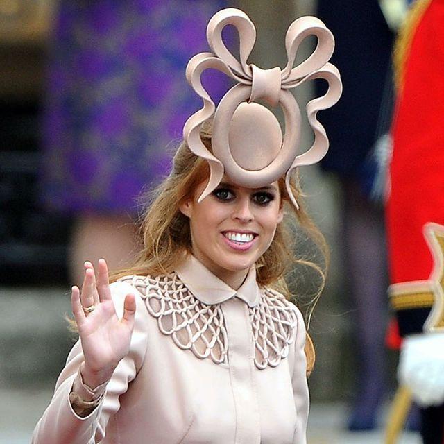 Ear, Headgear, Smile, Fashion accessory, Headpiece, Costume,