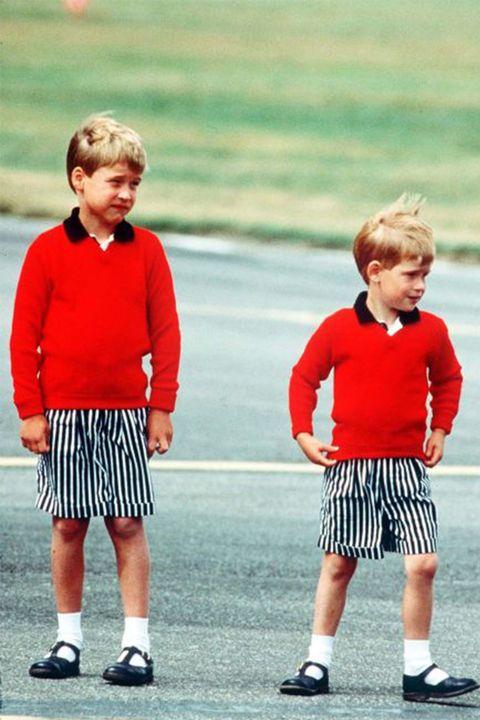 Clothing, Footwear, Leg, Sleeve, Human leg, Standing, Red, Child, T-shirt, Active shorts,