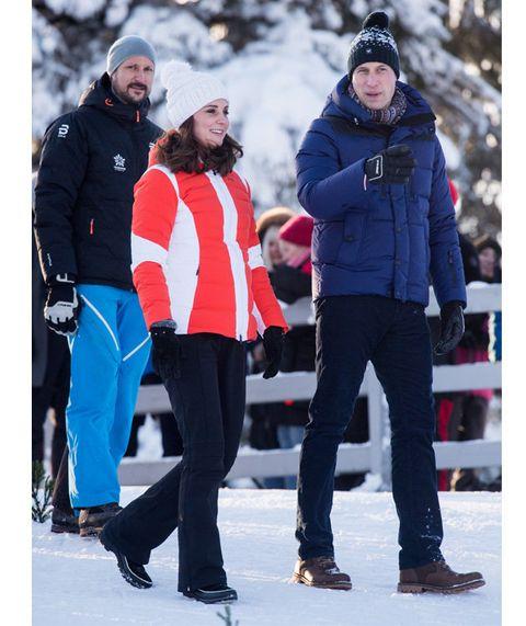 Snow, Winter, Recreation, Playing in the snow, Outerwear, Jacket, Footwear, Hood, Beanie, Winter sport,