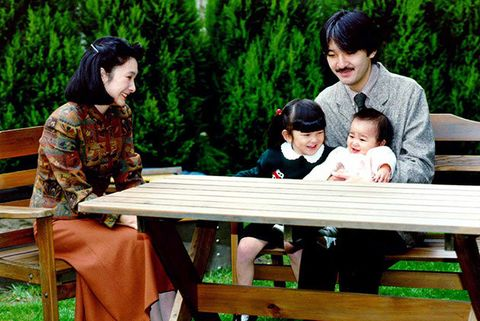 hair, face, sitting, furniture, leisure, outdoor furniture, table, black hair, sharing, outdoor bench,