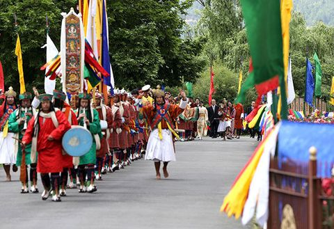 Event, Flag, Pole, Parade, Tradition, Public event, Festival, Costume, Fête, Sun hat,