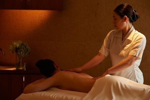 Spa, Massage, Massage table, Shoulder, Joint, Leg, Neck, Human body, Sitting, Hand,