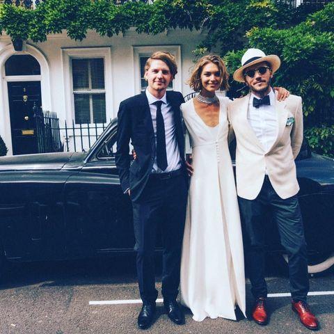 Clothing, Coat, Hat, Trousers, Photograph, Outerwear, Dress, Suit, Formal wear, Vehicle door,