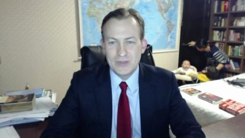 Clothing, Dress shirt, Coat, Chin, Forehead, Eyebrow, Collar, Suit, Outerwear, Tie,