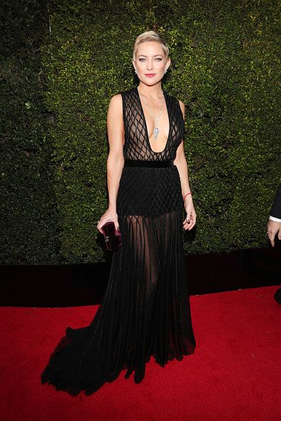Red carpet, Carpet, Dress, Clothing, Flooring, Fashion, Hairstyle, Gown, Premiere, Long hair,