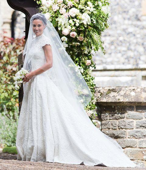 Wedding dress, Bride, Veil, Dress, Photograph, Gown, Clothing, Bridal clothing, Bridal accessory, Bridal veil,