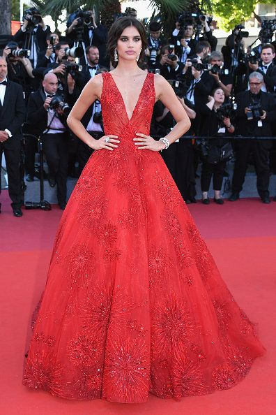 Gown, Dress, Red carpet, Fashion model, Carpet, Clothing, Flooring, Red, Haute couture, Premiere,
