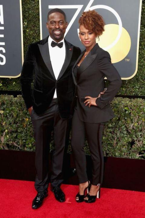 Suit, Formal wear, Tuxedo, Red carpet, Clothing, Carpet, Premiere, Flooring, Outerwear, Dress,