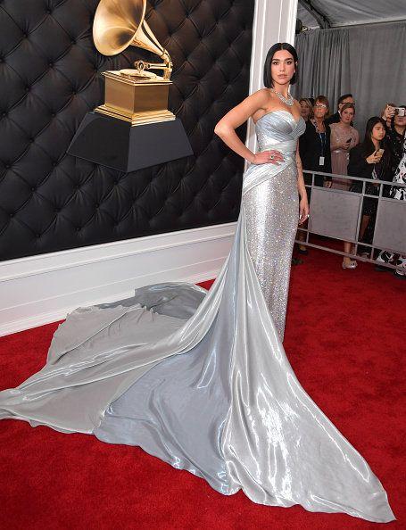Gown, Dress, Wedding dress, Carpet, Clothing, Red carpet, Fashion model, Flooring, Bridal accessory, Shoulder,