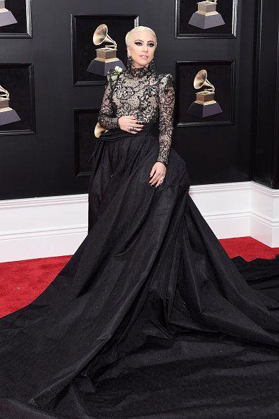 Carpet, Red carpet, Clothing, Dress, Gown, Fashion, Flooring, A-line, Haute couture, Shoulder,