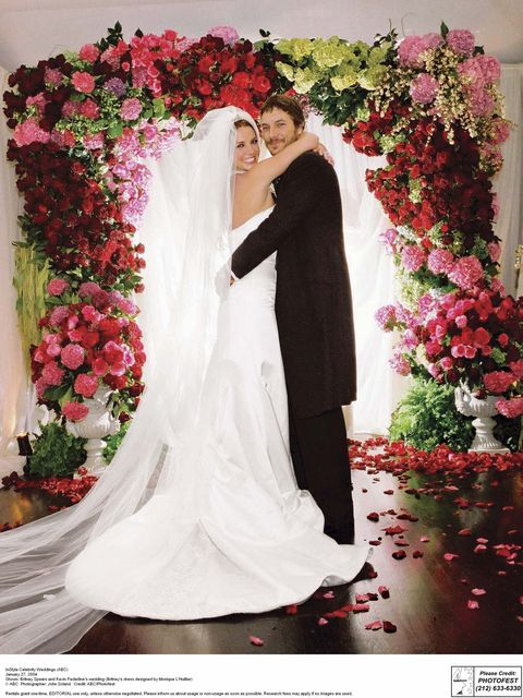 Photograph, Bride, Wedding dress, Flower Arranging, Marriage, Veil, Red, Ceremony, Floral design, Floristry,
