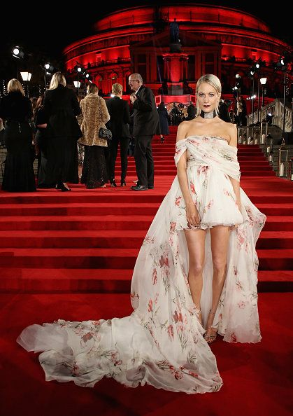 Red carpet, Carpet, Dress, Gown, Clothing, Fashion, Red, Flooring, Fashion model, Shoulder,