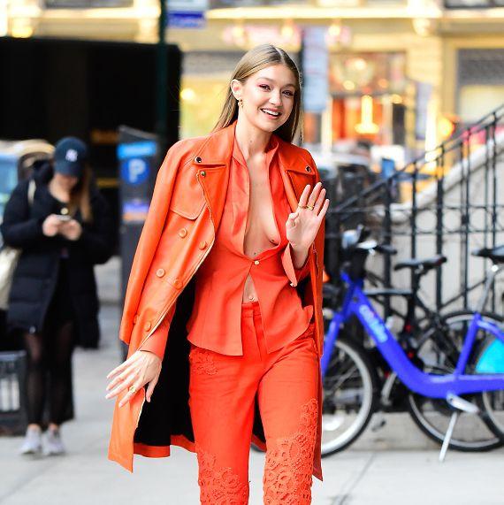 Clothing, Street fashion, Orange, Fashion, Fashion model, Outerwear, Electric blue, Blazer, Yellow, Coat,