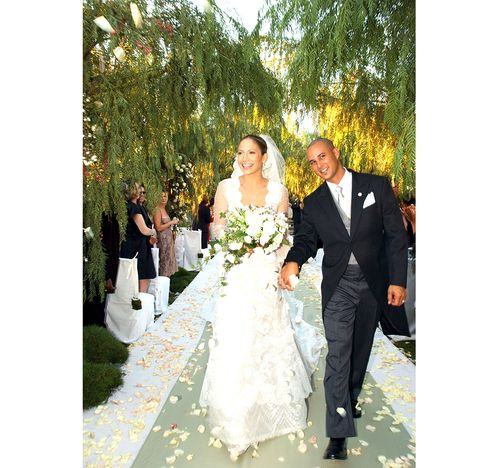 Clothing, Coat, Trousers, Dress, Bridal clothing, Petal, Photograph, Outerwear, Suit, Wedding dress,