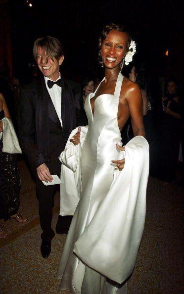 White, Formal wear, Dress, Gown, Suit, Fashion, Wedding dress, Event, Tuxedo, Haute couture,