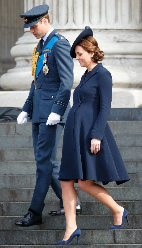 Clothing, Street fashion, Uniform, Fashion, Cobalt blue, Coat, Standing, Dress, Suit, Formal wear,