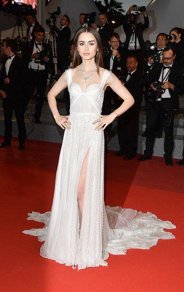 Red carpet, Fashion model, Gown, Dress, Carpet, Flooring, Clothing, Shoulder, Premiere, Fashion,