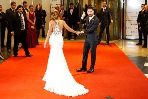Gown, Red carpet, Dress, Flooring, Carpet, Wedding dress, Photograph, Bride, Bridal clothing, Fashion,