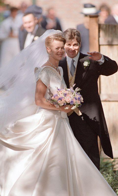 Bride, Wedding dress, Gown, Photograph, Dress, Bridal clothing, Facial expression, Marriage, Formal wear, Wedding,
