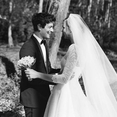 Bride, Photograph, Bridal veil, Gown, White, Wedding dress, Black, Facial expression, Wedding, Ceremony,