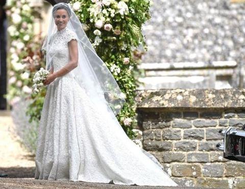 Clothing, Petal, Dress, Bridal clothing, Bride, Photograph, Wedding dress, Bridal veil, Gown, Formal wear,