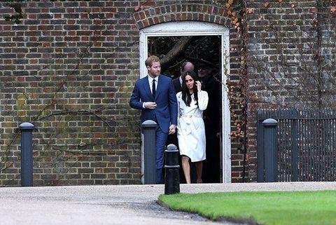 Photograph, Standing, Ceremony, Wall, Wedding, Dress, Brick, Formal wear, Event, Tree,